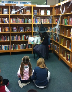 A witch reading a story at Kensington Central Library!