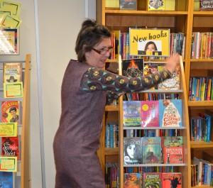 Penny Girling displaying new books for teens