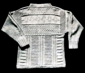 Inverness Guernsey, knitted in aran wool. A thick guernsey with an all over pattern on back and front, including flag and bar patterns on the body with chevron, diamond and double moss stitch panels on the yoke.