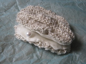 Knitted oyster, complete with pearl