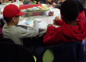 Colouring in footballs at North Kensington Library