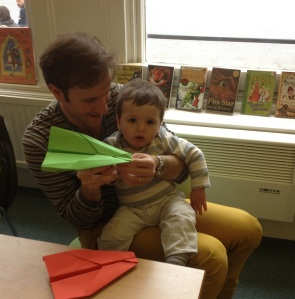 Father and child at Notting Hill Gate second craft session, with paper aeroplane