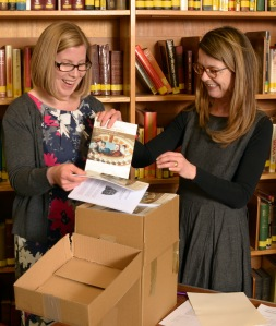 Author Tamara Pollock and Kim Klug from Historic Royal Palaces unpack the books.
