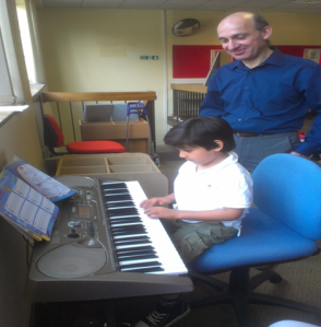 A budding maestro with the piano tutor