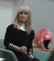 Toyah Wilcox with one of her head dresses in the background. Photo by Debby Wale