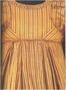 Woman's dress of woven silk with applied plated trimming, lined with linen. British, about 1805.