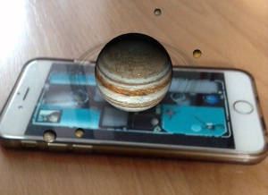 Picture of iSolarSytem App in action, with moons rotating around a planet