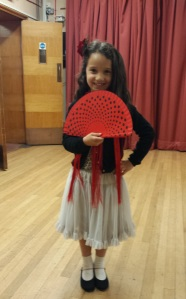 Picture of young person with flamenco accessories (fan and skirt)