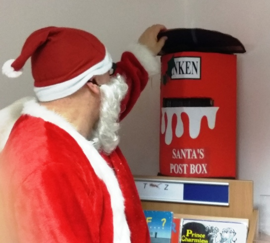 Santa picking up his letters